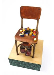 """Sculpture by Ruth Lozner titled """"Nineteen Fifty-Four,"""" School chair, children's blocks, shoes and truck, 11"""" x 24' x 14"""""""