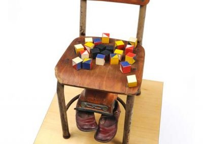 """""""Nineteen Fifty-Four,"""" School chair, children's blocks, shoes and truck, 11"""" x 24' x 14"""""""