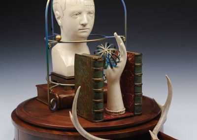 """Small sculpture by Ruth Lozner titled """"Dr. Mesmer's Theory of Animalia Magnetism,,"""" Wood, ceramic, metal, found objects, antlers, magnet, 19"""" x 23"""" x 25"""""""