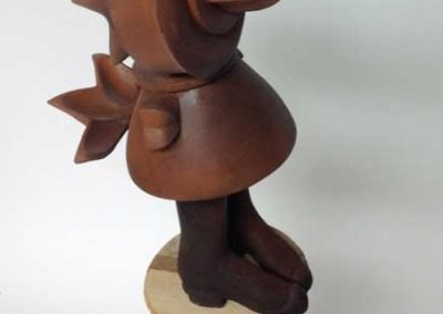 """Small sculpture by Ruth Lozner titled """"Indutus Pullam (The Dressed Chicken),"""" Wood, 7"""" x 32"""" x 9"""""""