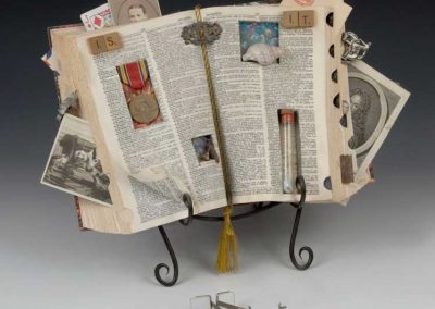 """Small sculpture by Ruth Lozner titled, """"Is It,"""" Dictionary, various found objects, 16"""" x 14"""" x 4"""""""