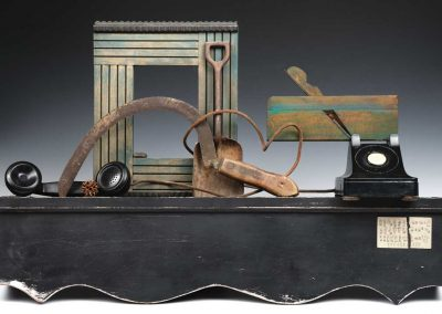 """Small sculpture by Ruth Lozner titled """"Nearing Silence,"""" Wood, found objects including telephone, 32"""" x 21"""" x 7"""""""