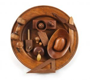 """Small sculpture titled """"Table of Contents,"""" Wood, 22"""" round"""
