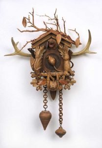 """Small sculpture by Ruth Lozner titled """"Time Divides Before and After"""" Vintage cuckoo clock and various wooden found objects, 18"""" x 24"""" x 6"""""""