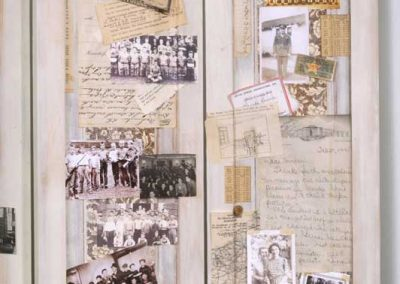 """Collage Detail 3 titled """"War, Peace, War, Peace, War, Peace… (the Cultivation of Soldiers),""""Collage, various found objects, including a WW11 Medic's Log, slide specimens, and Morse Code device, ephemera and photos, 42"""" x 75"""" x 15"""" created by Ruth Lozner"""